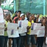 Relatives and friends of another slain black youth stage a protest in front of a shopping mall.