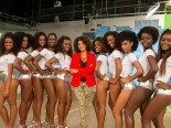 "Ten women compete to become the new ""Globeleza"" beauty. The beauties surround actress Sheron Menezes (in red)"