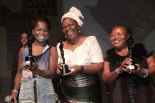 Brazilian actress Zeze Barbosa, Mozambican writer/activist Paulina Chiziane and president of the Domestic's union in Brazil, Creuza de Oliveira pose with their awards at the 2013 Troféu Raça Negra