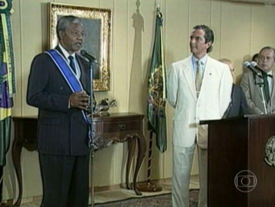 Speaking in 1991 as then President Fernando Collor looks on