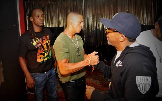 Spike Lee greets rapper Mano Brown of the Racionais MCs