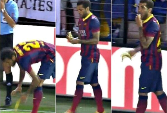 Daniel Alves picks up and eats banana thrown at him during a recent match