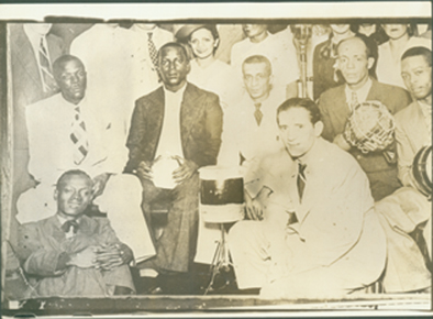 Early samba greats - Top: Marçal, Tibelo, Bide, Lourenço and Ioiô. Bottom: Heitor dos Prazeres, in the center is Francisco Alves
