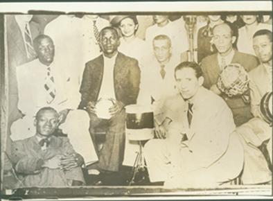 Early samba greats - Top: Marçal, Tibelo, Bide, Lourenço and Ioiô. Bottom: Heitor dos Prazeres, in the center is Francisco Alves