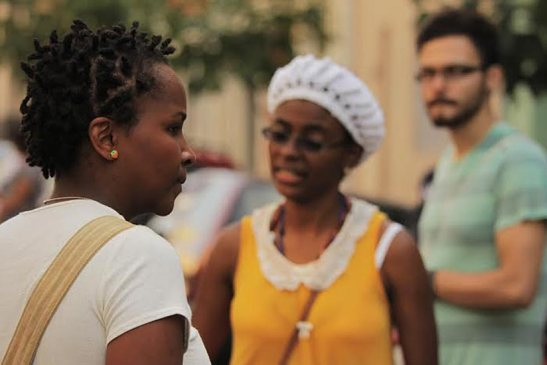 Filmmaker Viviane Ferreira (in yellow) on the set of the short film