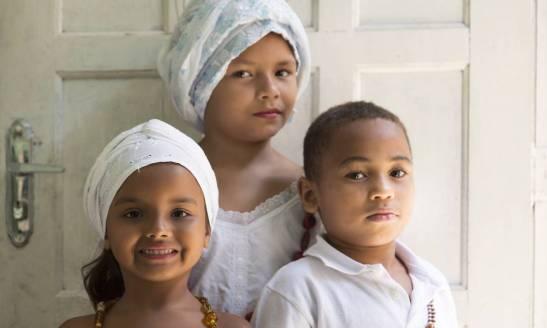 The tradition is being passed on to her grandchildren. Danda Caroline Silva, Richard Matheus Marinho and Dandara Sophia Silva (below) are among them.