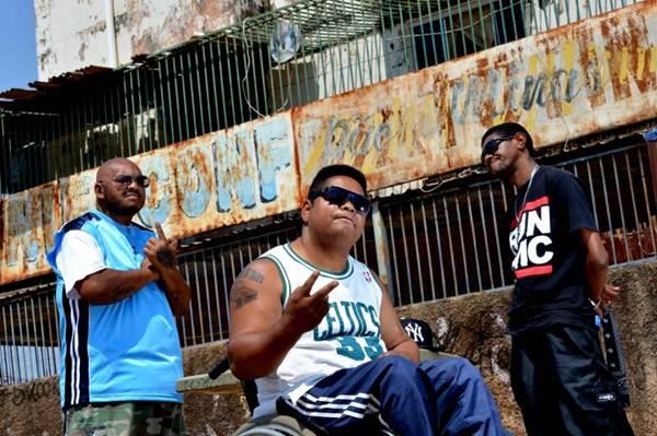 """Dj Jamaika (left), Marquim da Tropa and Dino Black, appeared in the cast of the film """"Branco sai, preto fica"""""""