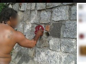 One of the suspects posted a photo of himself spray painting the monument in a social netowrk