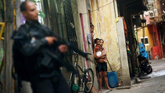 Military Police patrol the Maré favela of Rio de Janeiro