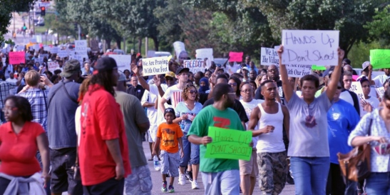 Protesters in Ferguson, Missouri occupy streets in protest to the murder of Mike Brown