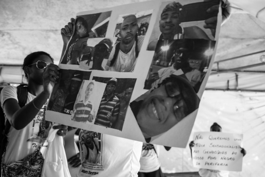 Participant in march displays photos of vicitms