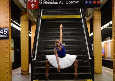 Silva strikes a pose in the New York City subway