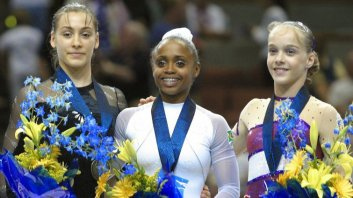 Catalina Ponor, Daiane and Elena Gomez - World Gymnastics Podium 2003 (AFP Photo/Robyn Beck)