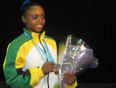 Daiane dos Santos comemora o bronze no evento-teste em Londres