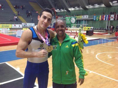 Gymnast Henrique Flores appears at the side of his father Marcos Goto