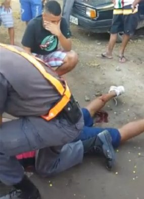 Still from video shows pain bleeding after being shot by police