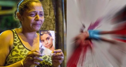 Terezinha Maria de Jesus, 40, holds a photo of her 10-year old son who was gunned by police in Rio