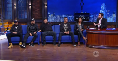 "Negra Li with members of the Hip Hop group RZO on ""The Noite"""
