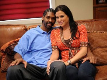 NBA basketball player Nenê Hilário and wife Lauren