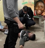 Photo of the body of young Cristian Andrade Soares, 12, who according to residents of the favela of Manguinhos, north of Rio, was shot by UPP officers while playing futebol.