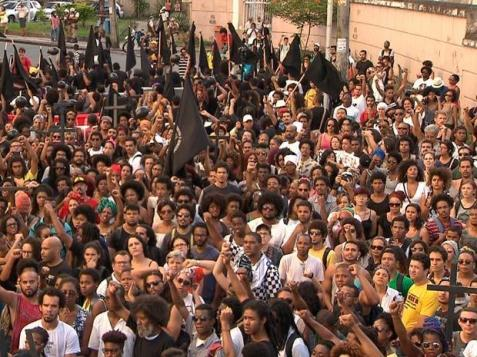 Participants of the public march against concentrated genocide in front of the headquarters of the Military Police in Salvador