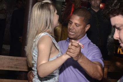 Former futebol star Marcelinho Carioca enjoys himself with a blond