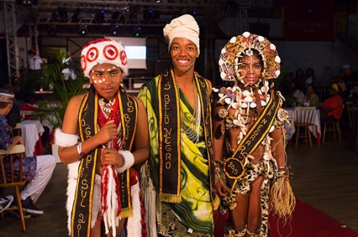 The Mais Belo Negro do RS (Most Handsome Black Man of Rio Grande do Sul), Venir Xavier Neto and junior representatives of 2015, Victor Gabriel Alves and Sandry Nadine Escobar, attended the event