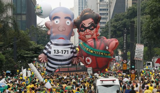 Demonstrators in Sao Paulo parade inflatable dolls depicting former Brazilian President Luiz Inacio Lula da