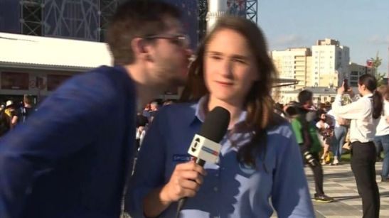 A man attempting to kiss sports reporter Julia Guimaraes while she was working in Russia